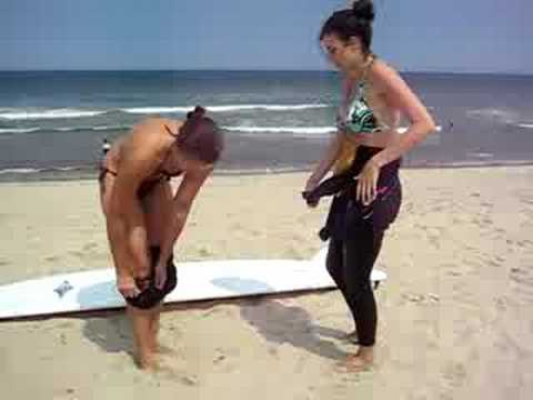 Video of a nude girl getting in a wetsuit