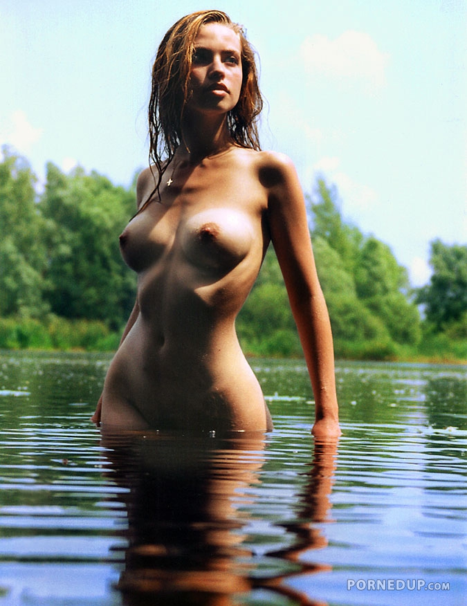 Sexy girl naked in water
